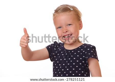 Portrait of a happy young girl showing thumbs up on white background - stock photo