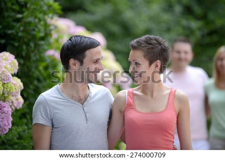 Portrait of a happy young heterosexual couple flirting - stock photo