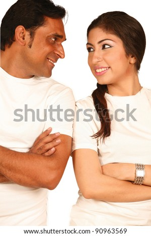 Portrait of a happy young indian couple having fun together against white background