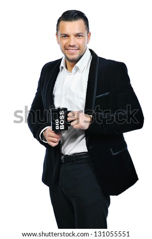 Portrait of a happy young man holding cup isolated on white - stock photo