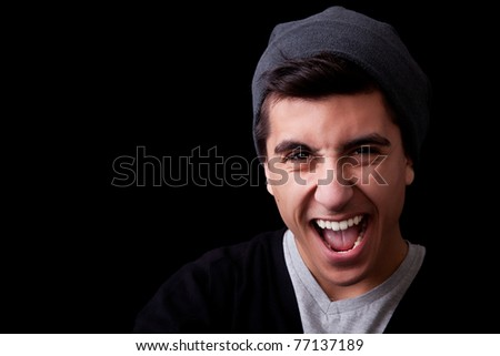 Portrait of a happy young man on black background. Studio shot. - stock photo