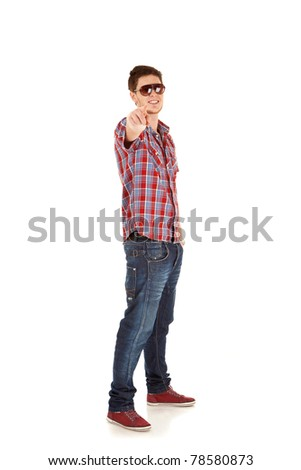 Portrait of a happy young man pointing at camera - stock photo