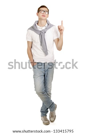 Portrait of a happy young man pointing at something interesting on white background