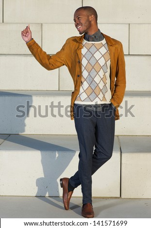 Portrait of a happy young man posing outdoors - stock photo