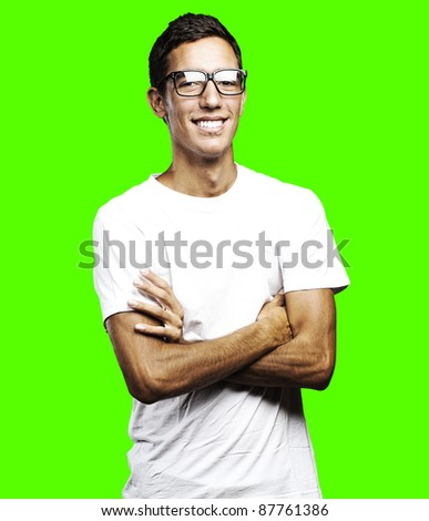 portrait of a happy young man smiling against a removable chroma key background - stock photo