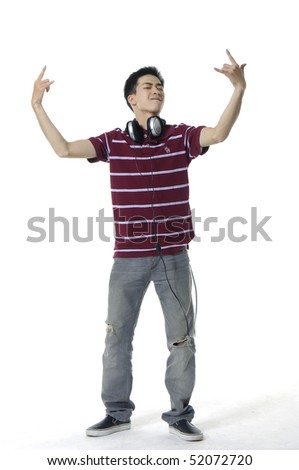 Portrait of a happy young man smiling, with headphones. - stock photo