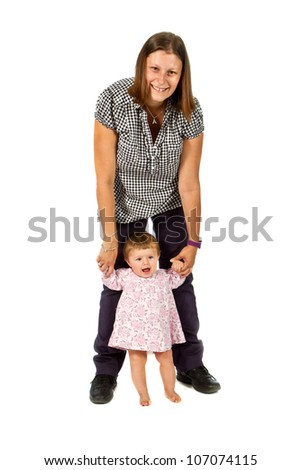 Portrait of a happy young mother holding baby girl - stock photo