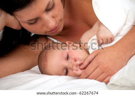portrait of a happy young mother with love looking at baby