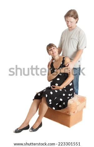 Portrait of a happy young pregnant woman with her boyfriend - stock photo