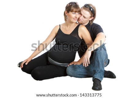 Portrait of a happy young pregnant woman with her husband - stock photo