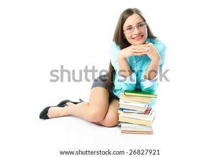portrait of a happy young student on the floor with a lot of books