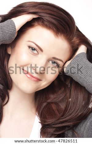 Portrait of a happy young woman. Isolated on white background