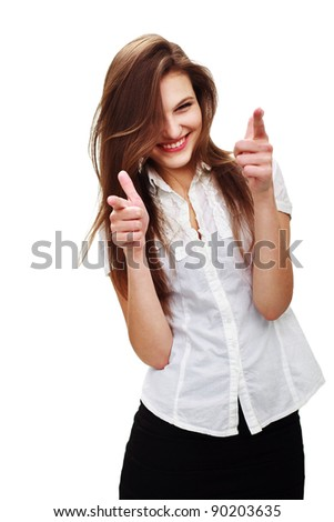 Portrait of a happy young woman pointing at you against white background