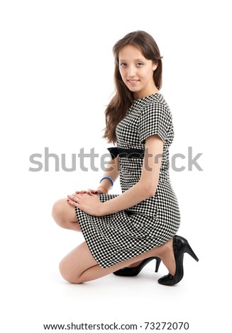 Portrait of a happy young woman smiling against white background - stock photo