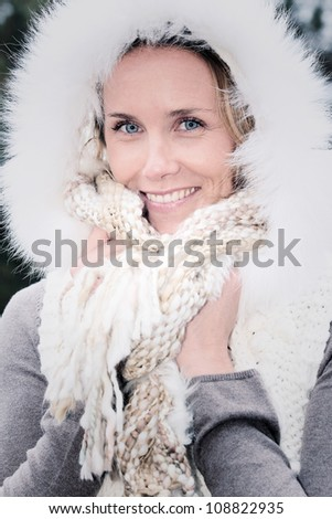portrait of a happy young woman smiling in autumn - stock photo