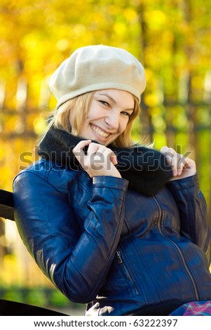 Portrait of a happy young woman smiling outdoor