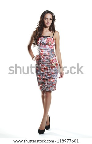 Portrait of a happy young woman standing with folded hands on white background - stock photo