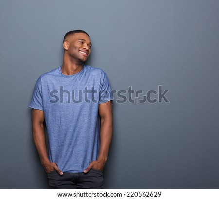 Portrait of a healthy african american man smiling on gray background - stock photo