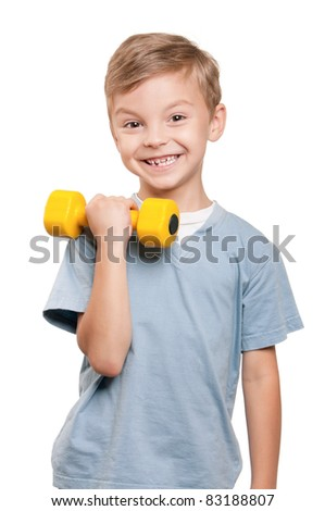 Portrait of a healthy little boy working out with dumbbells over white background - stock photo