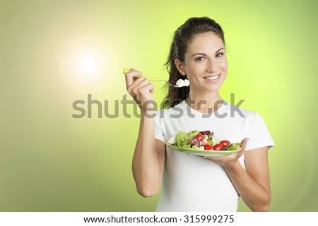 portrait of a healthy woman eating a salad
