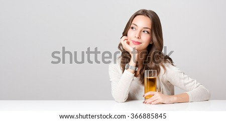 Portrait of a healthy young brunette beauty with glass of apple juice.