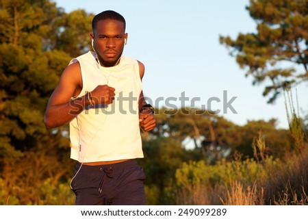 Portrait of a healthy young man exercising in nature - stock photo