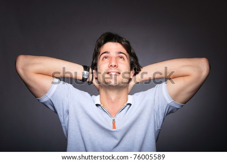 portrait of a heandsome youg man over gray background - stock photo