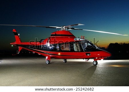 Portrait of  a helicopter against a sunset sky. - stock photo