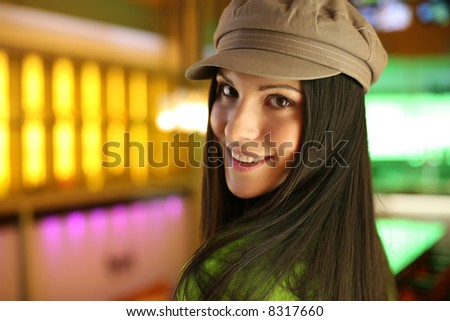 Portrait of a hip beautiful young woman in cap hat. Shallow DOF. - stock photo