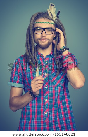 Portrait of a hippie young man in spectacles.