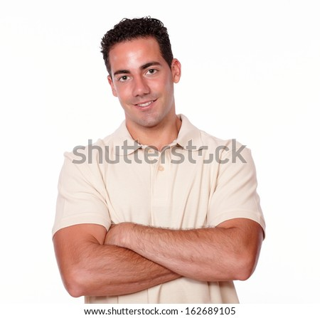 Portrait of a hispanic man on stylish t-shirt smiling and crossing his arms while is looking at you on isolated studio