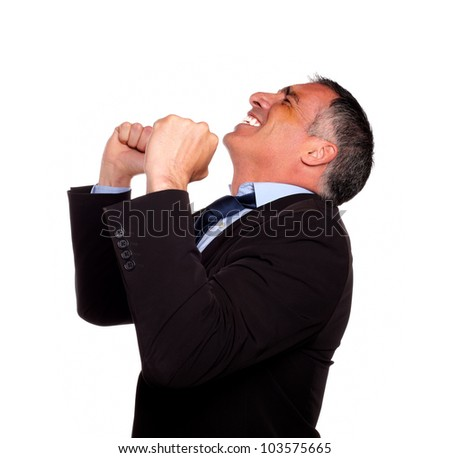 Portrait of a hispanic senior broker celebrating very happy a victory on isolated background - stock photo