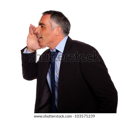 Portrait of a hispanic senior businessman on black suit whispering against white background - stock photo