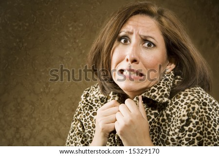 Portrait of a Hispanic woman recoiling in fear - stock photo