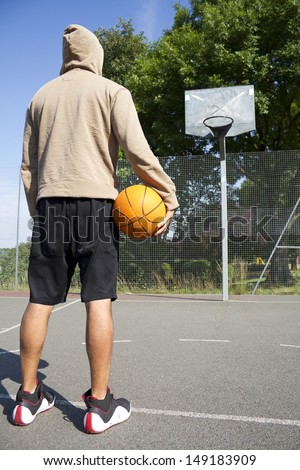 Portrait of a hooded Basketball Player facing the ring. Concept of sports challenge or competition - stock photo