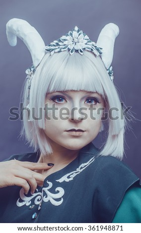 Portrait of a horned girl - stock photo