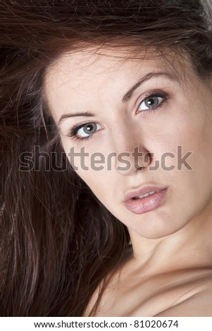Portrait of a hot young woman looking confidently - stock photo
