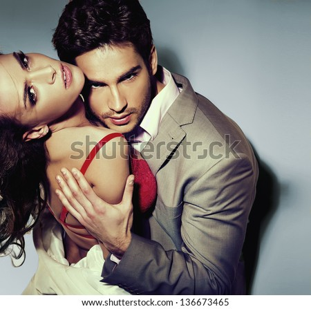 Portrait of a hugging couple - stock photo