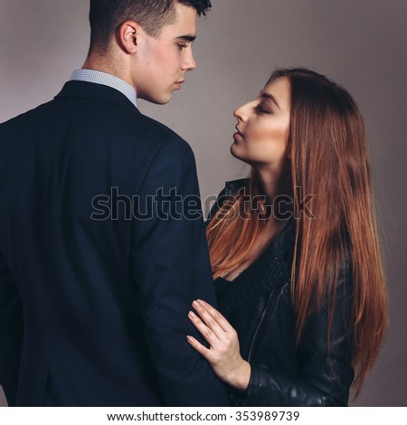 Portrait of a hugging couple. Young elegant couple in evening dress portrait. - stock photo