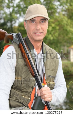 Portrait of a hunter - stock photo