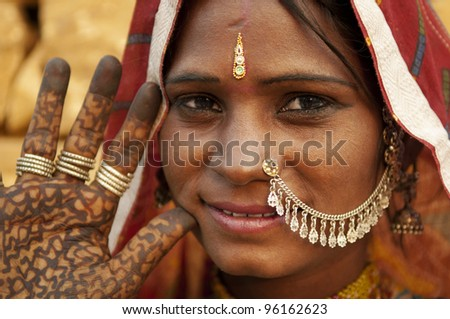 Portrait of a India Rajasthan woman with her henna tattoo - stock photo