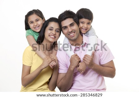 Portrait of a Indian family smiling over white background - stock photo