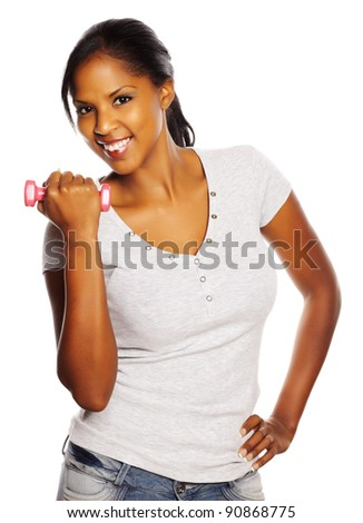 Portrait of a isolated young pretty black woman doing exercise. - stock photo