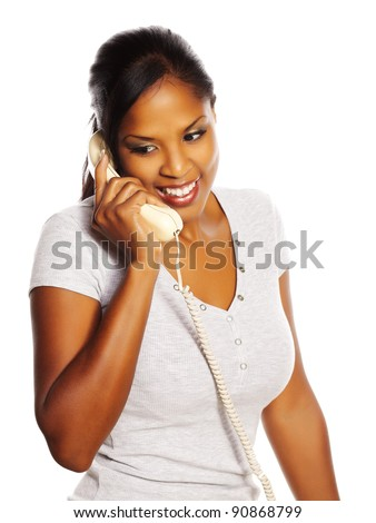Portrait of a isolated young pretty black woman on the phone. - stock photo