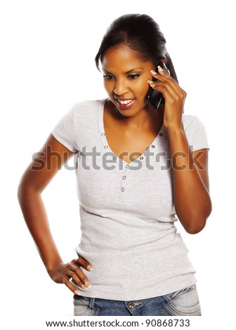 Portrait of a isolated young pretty black woman using a mobile phone.