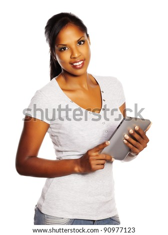 Portrait of a isolated young pretty black woman using a Tablet PC. - stock photo