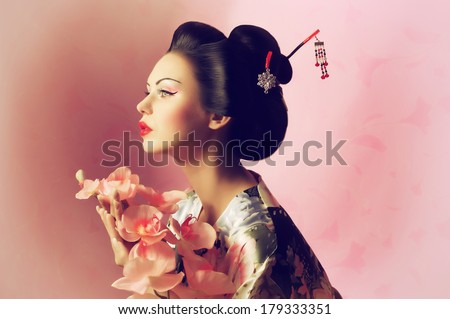 Portrait of a Japanese geisha woman - stock photo
