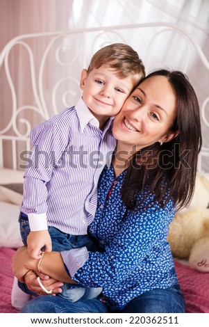 Portrait of a joyful mother and her children smiling at the camera - stock photo