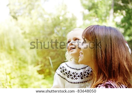 Portrait of a joyful mother and her daughter smiling - stock photo