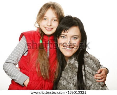 Portrait of a joyful mother and her daughter smiling at the camera - stock photo